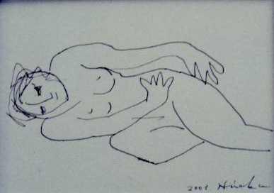 横たわる女